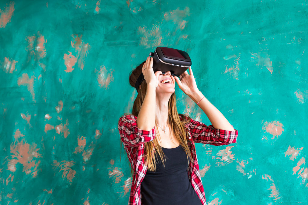 woman using a virtual reality device to illustrate sales incentives ideas | Element - The Prize & Incentive People